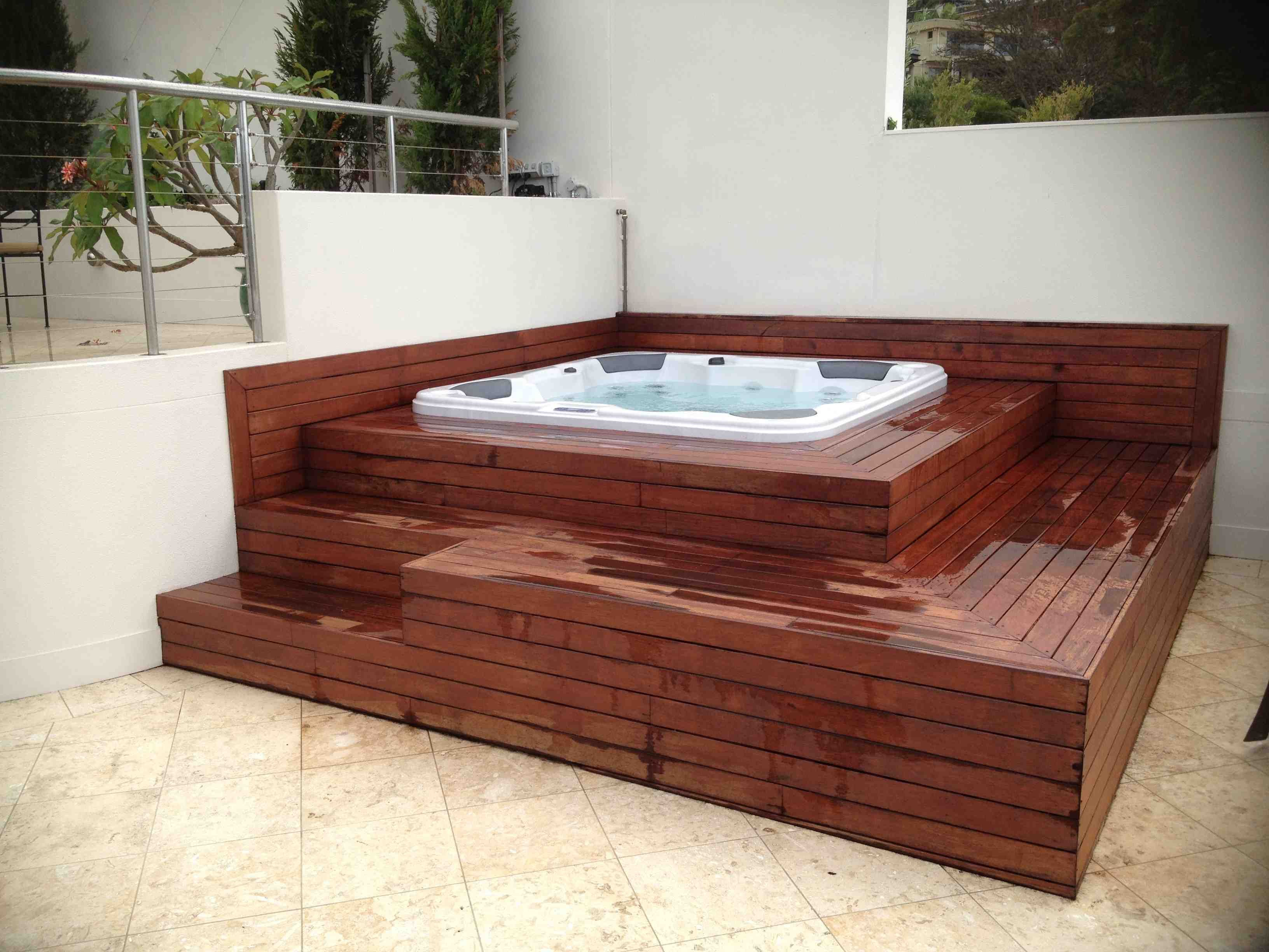 Portable spa in multi level deck on the rooftop for Garden decking with hot tub