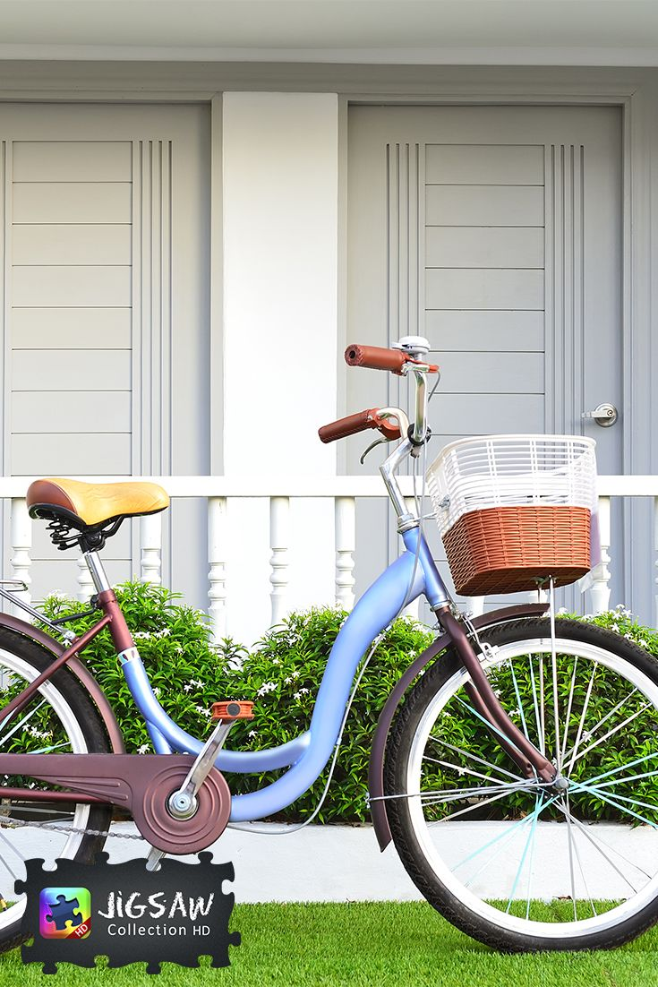 Blue bicycle by the frontage with flowers, outdoors photo