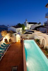 The pool at night in this Andalucian village holiday accommodation