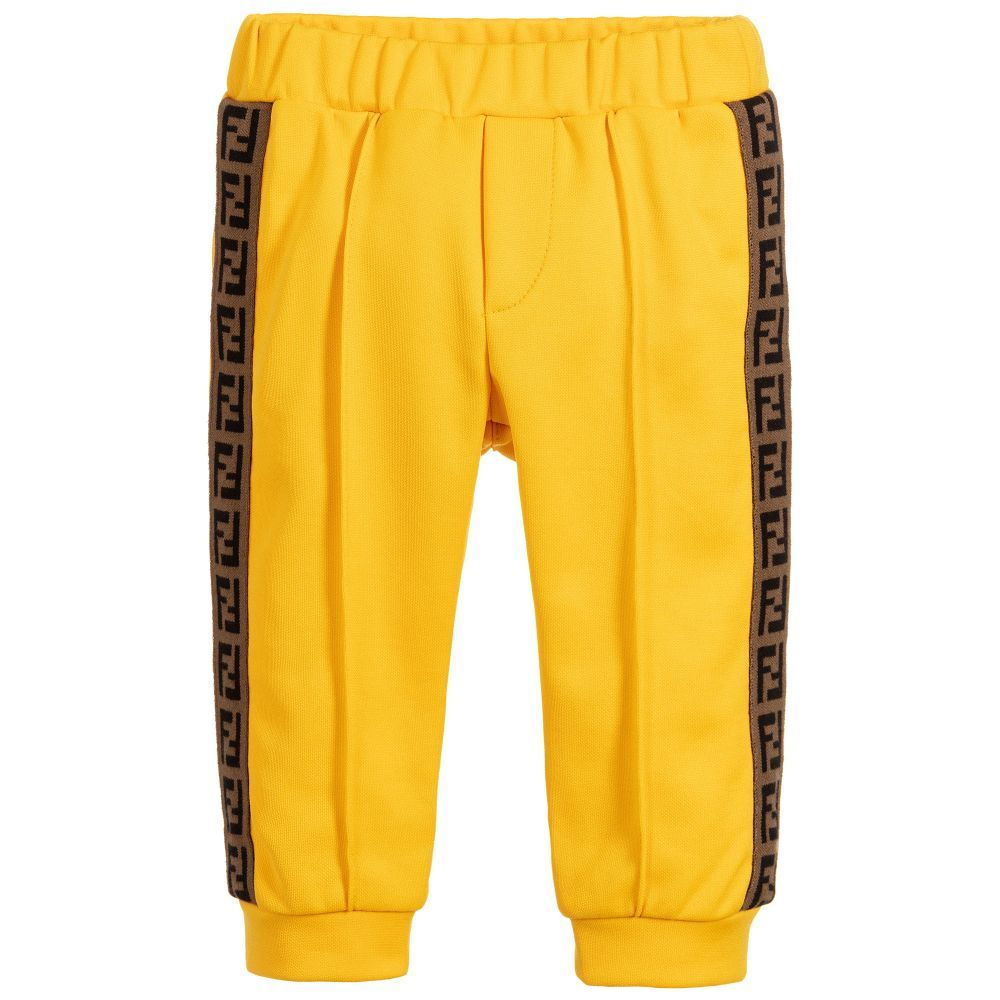 103e06b062223b Baby boys yellow trousers from Fendi, made in a stretch polycotton blend.  The sides have a beige 'FF' logo tape trim, with ankle cuffs and an  elasticated ...