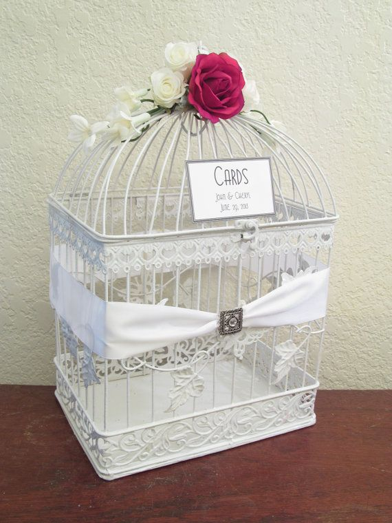 use a vintage bird cage as our wedding card box and decorate it