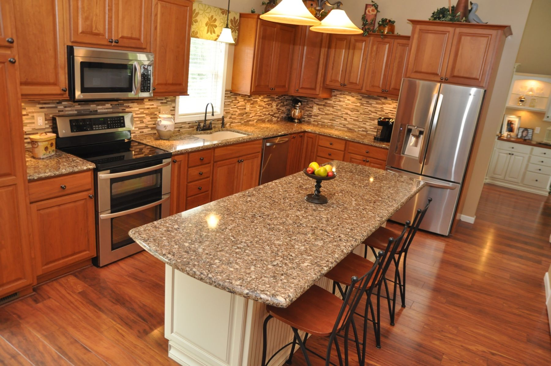 Kitchen Remodel Using Showplace Cherry Wood Cabinetry Cambria Quartz Count Cherry Wood Kitchen Cabinets Kitchen Cabinets And Countertops Cherry Wood Kitchens