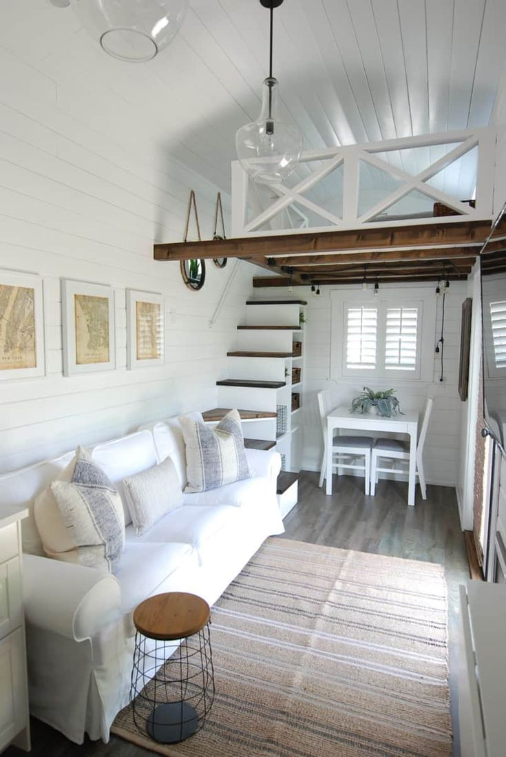 Coastal living room with white couch and rustic beams #tinyhomes