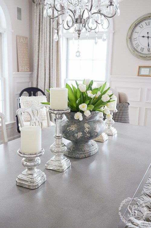 Just a dining room white tulips urn and florists for Dinner table flower arrangements
