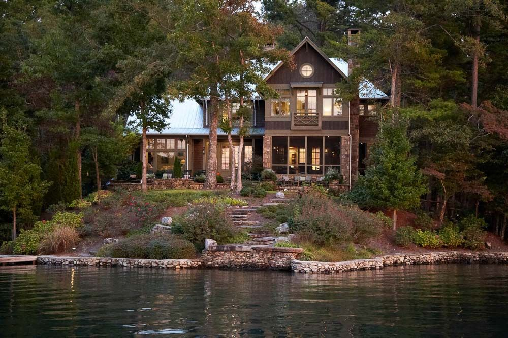 Spectacular lake house peacefully nestled on Lake Burton, Georgia is part of Lake houses exterior - This gorgeous lake house was designed by architects Pritchett + Dixon, nestled on a spectacular piece of property along Lake Burton, a reservoir in Georgia