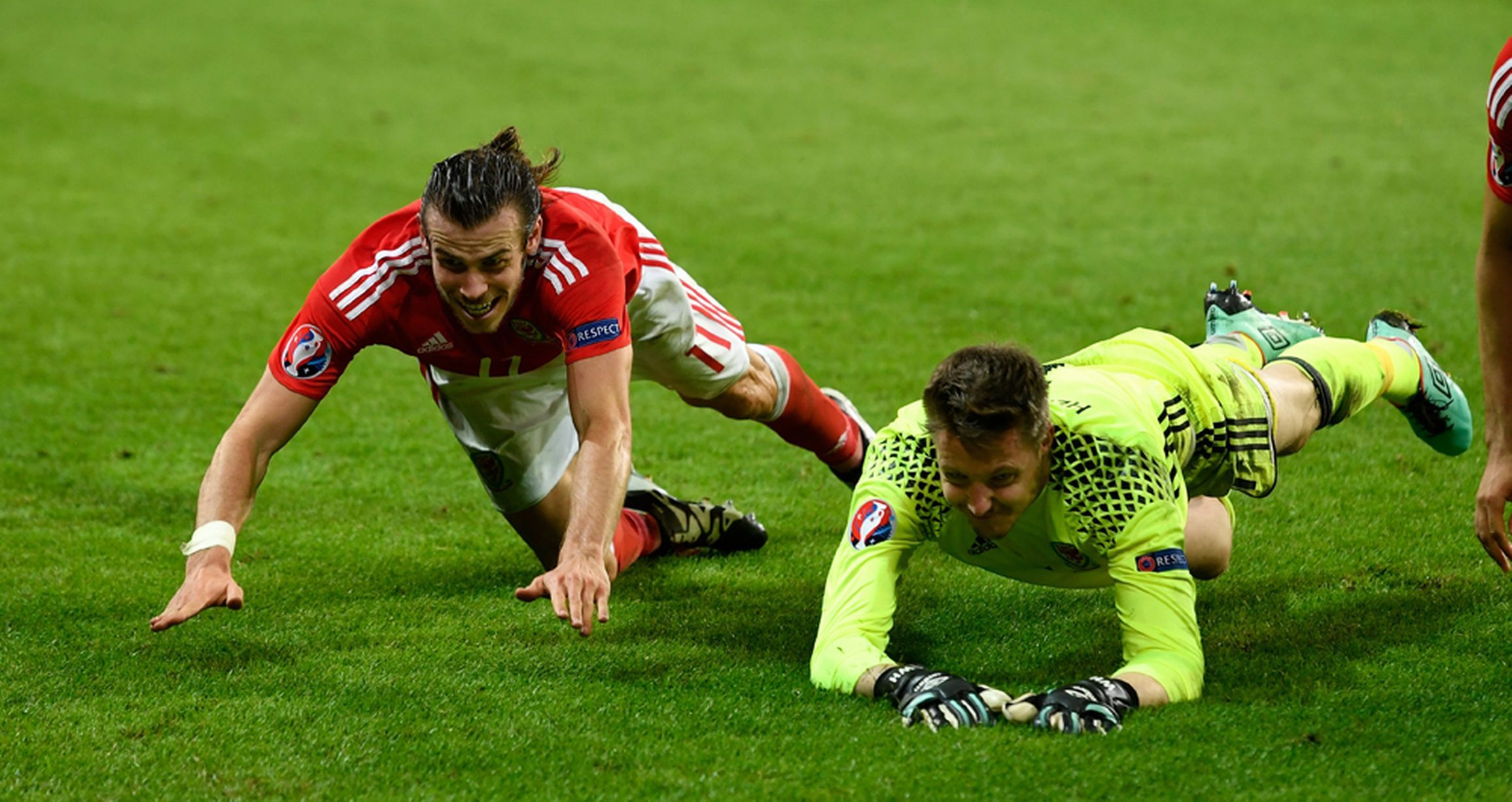 Gareth Bale and Wayne Hennessey of Wales celebrate their team's 3-1 win.