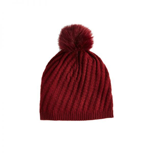 - Beanies are essential anytime there's a chill in the air. This vibrant red hue and adorable pom-pom detail will inject a little life into a ho-hum outfit.Ann Taylor Ribbed Pom Pom Hat, $50