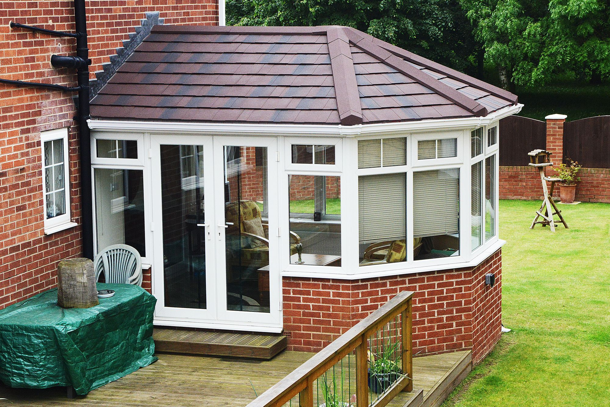 Large Supalite Tiled Conservatory Roof With Burnt Umber Metrotiles And White Guttering To Match Exis Tiled Conservatory Roof Conservatory Roof Composite Door