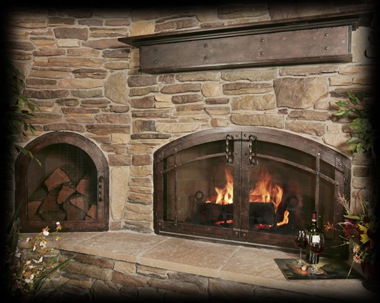 Doors Stone Fireplace : Stone surround with iron mantel and doors fireplace