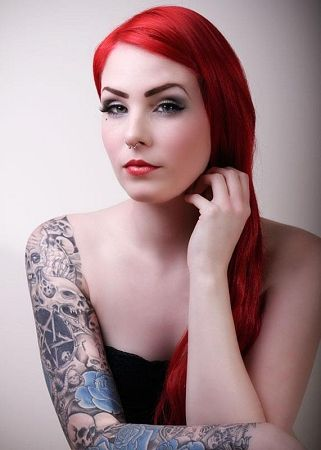 Hot redhead with tattoos