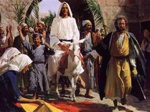 Jesus enters Jerusalem.