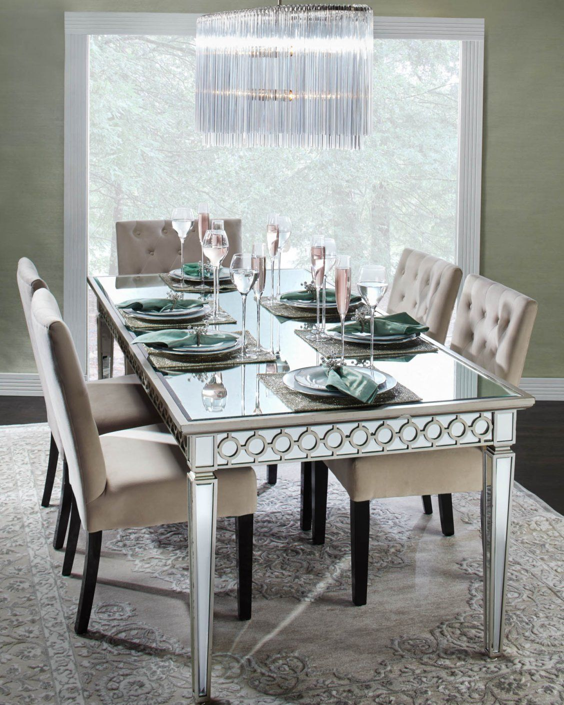 Hand applied beveled mirror detailing shines on this sophie mirrored dining table this handcrafted collection reinterprets classic form and detail for the