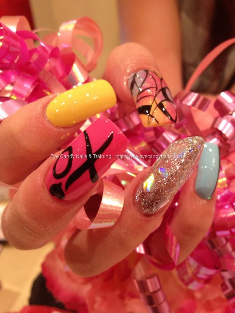 Yellow, blue, pink and silver freehand nail art with silver glitter ...