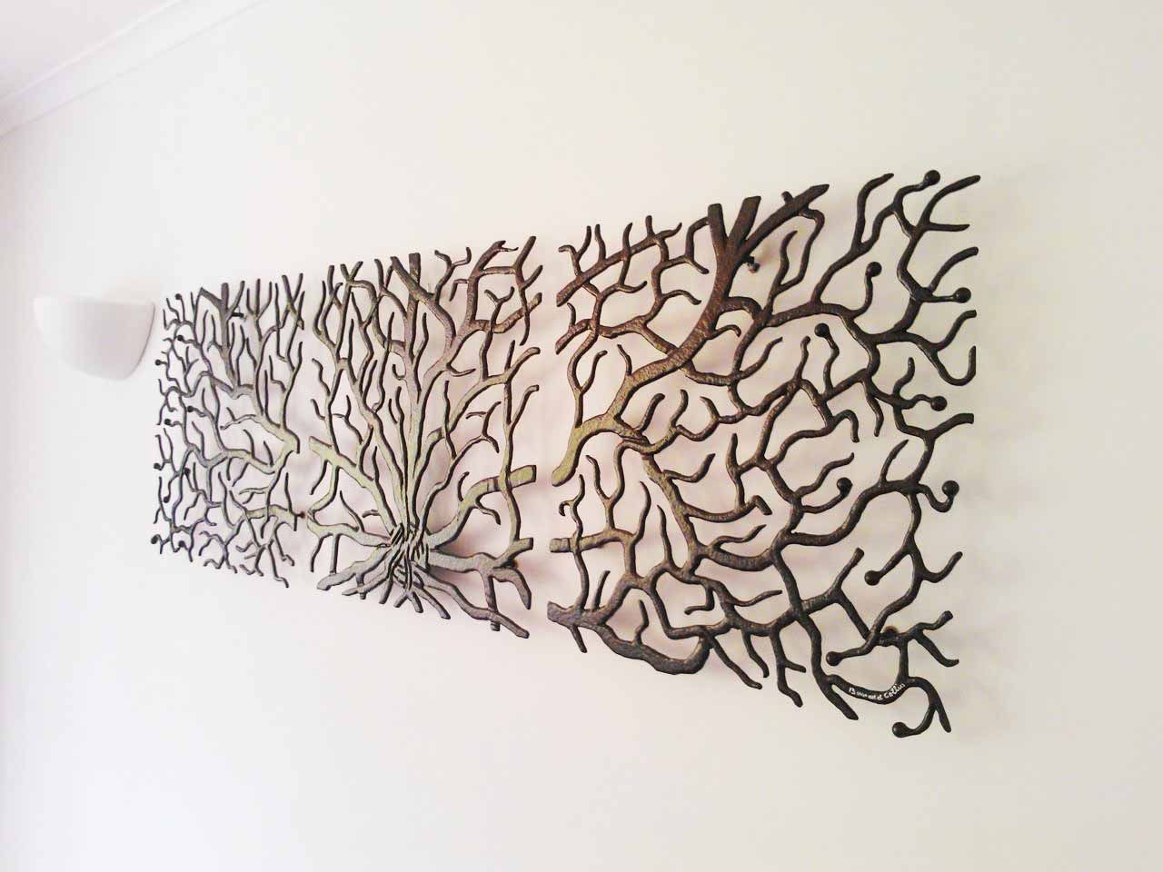 a temporary cloud-like art metal wall relief at reception area