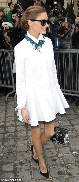 White hot: Borrowing from the collection, the former City star turned fashion blogger wore a white shirt dress featuring a ruffled skirt ove...