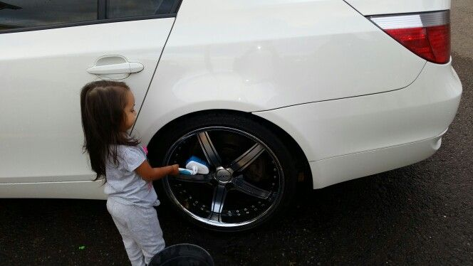 My baby niece cleaning my rims as big as she is lol