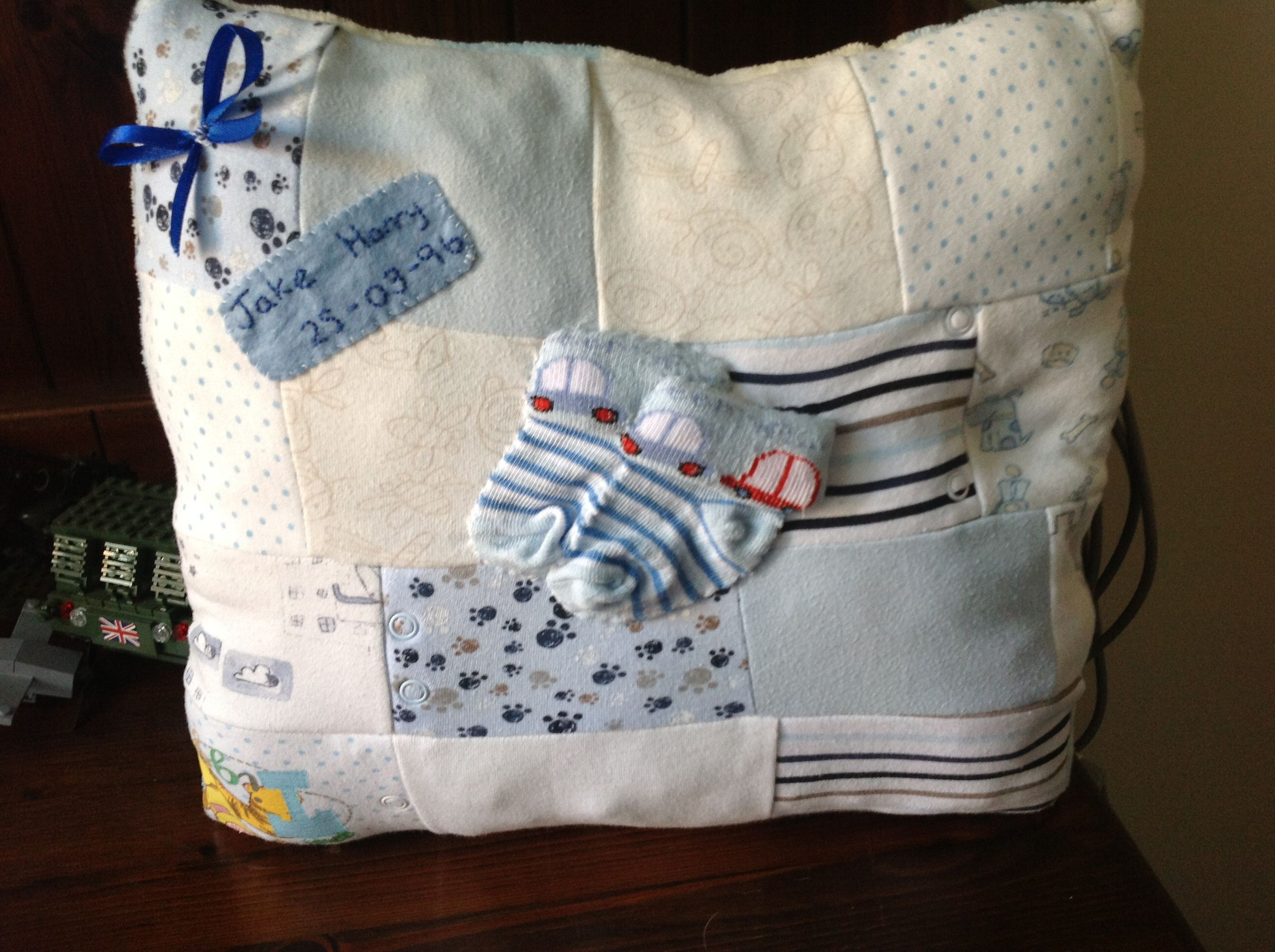 Handmade keepsake cushion  Made from babies first clothing a lovely memory for anyone :-)   Www.facebook.com/pages/mandas-monkeys/455915481158771