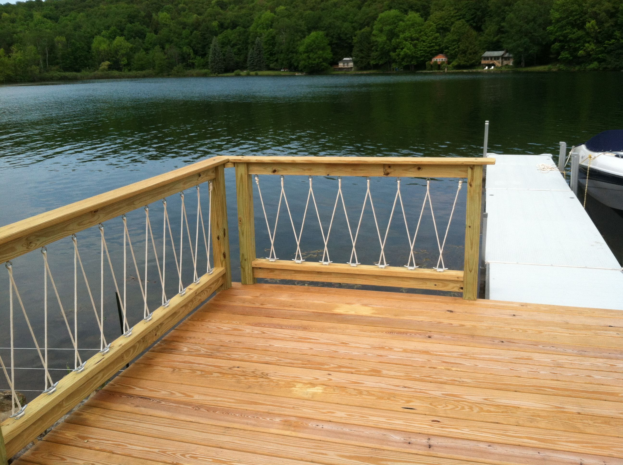 Awesome cantilevered deck and nautical railing house for Exterior balcony design