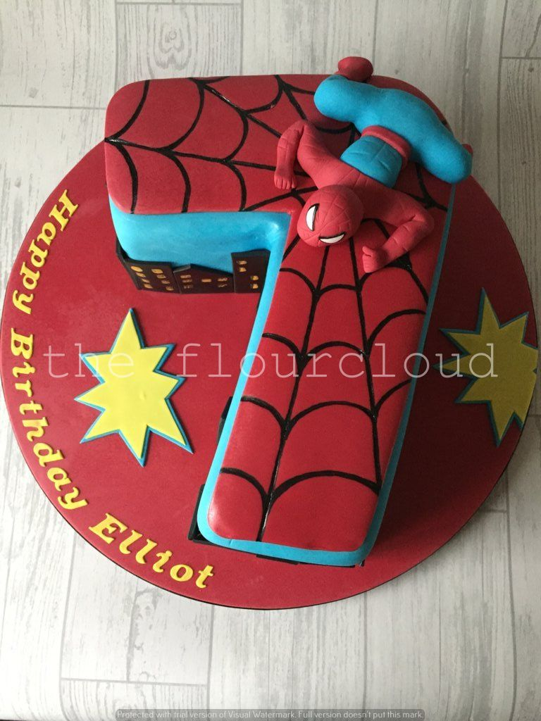 A number 7 birthday cake with an awesome Spiderman theme