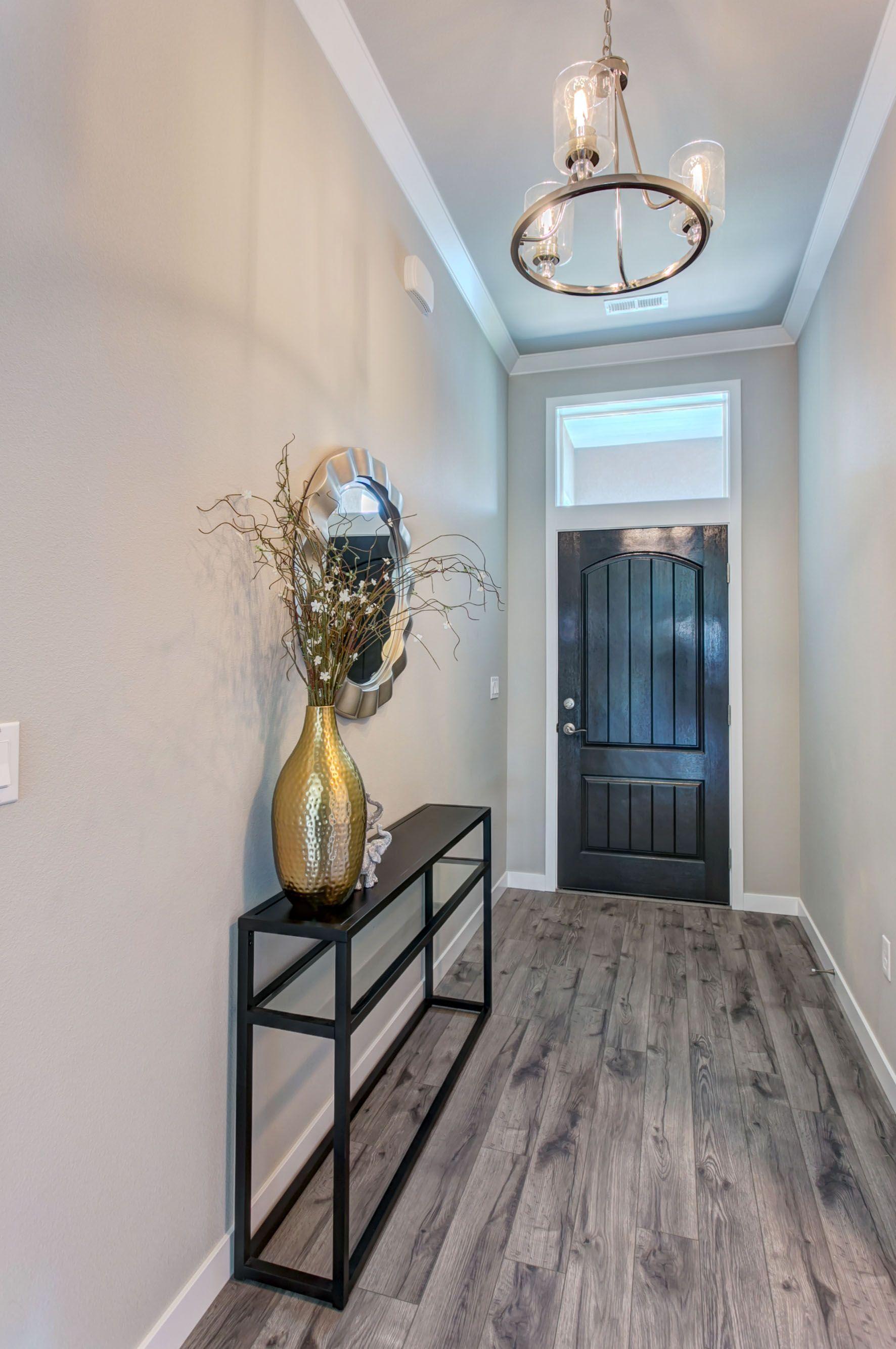 Legato Prodigy Homes Inc Warm Grey Walls Grey Walls Living Room Grey Laminate Flooring