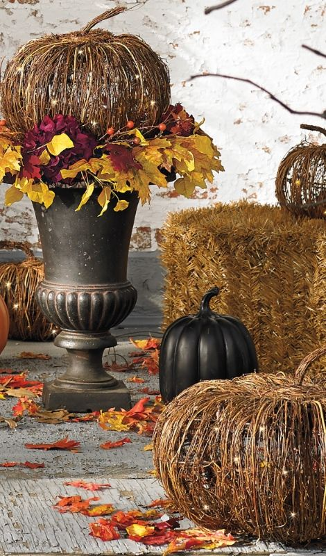 Enchant your harvest decor with the handcrafted appeal of our Pre-lit Grapevine Pumpkins.
