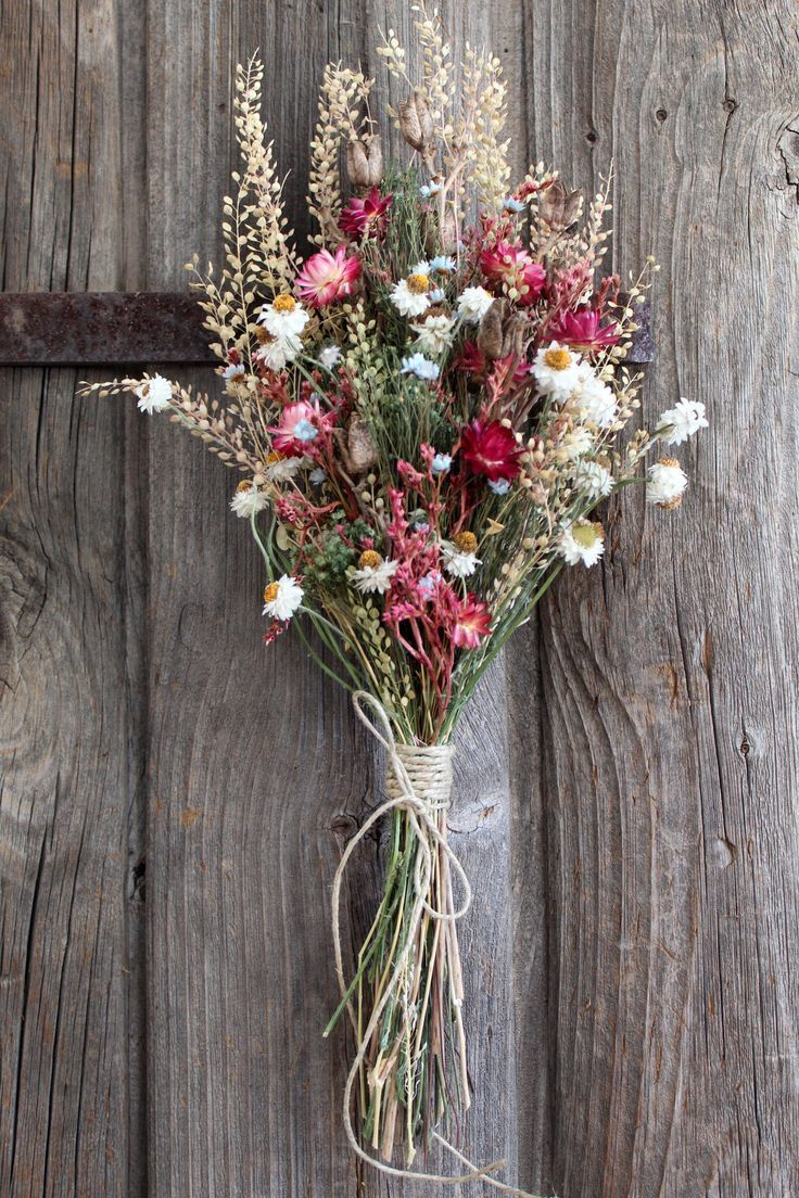 Handcrafted dried flower bouquet flowers include pink strawflowers, pepper grass…