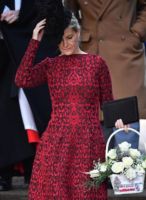 As she carried a white floral arrangement, Sophie, Countess of Wessex looked fantastic in her red and black dress