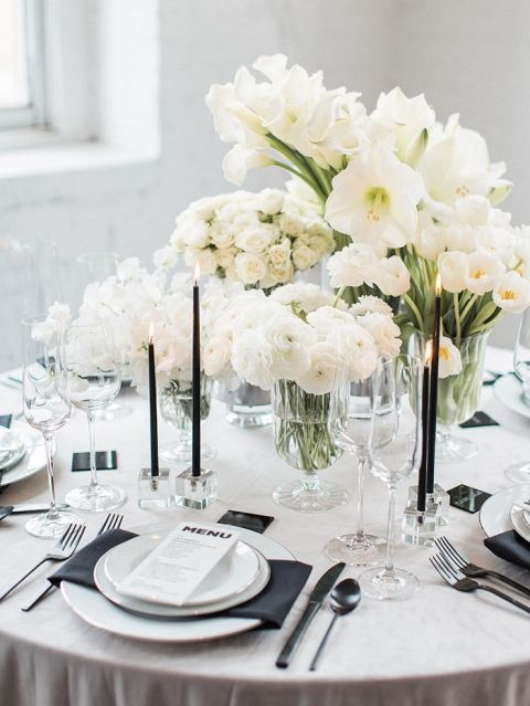 White Ranunculus Sweet Pea Amaryllis Tulips Mini Roses And Calla Lilies In Urn Gl Vases Wedding Tablescape