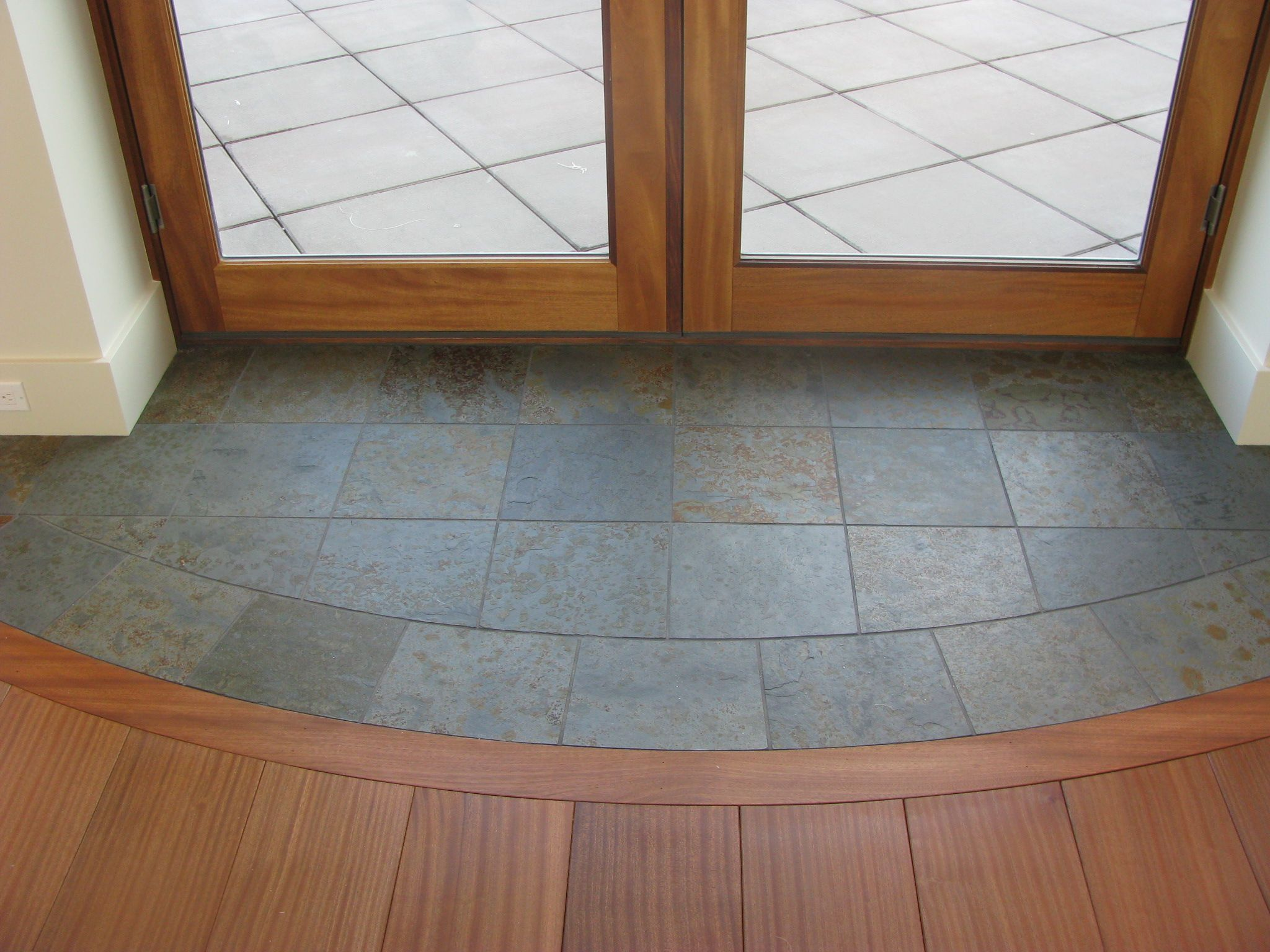 Slate entryway to protect hardwood floors at french door for Indoor outdoor flooring options