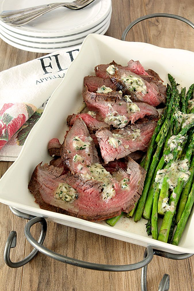 Easy and fabulous summer meal; this Grilled Flank Steak and Asparagus with Béarnaise Butter is so easy and yet still as sophisticated as it's name!