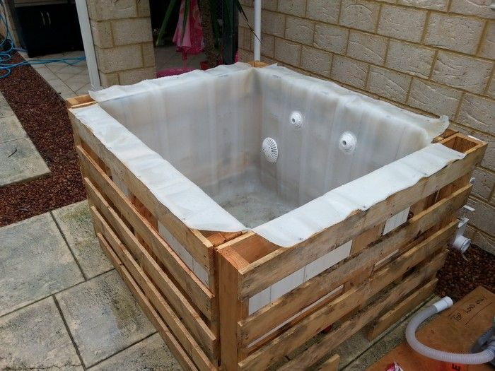 Learn how to build a plunge pool with pallets and an ibc for Koi pond pool table