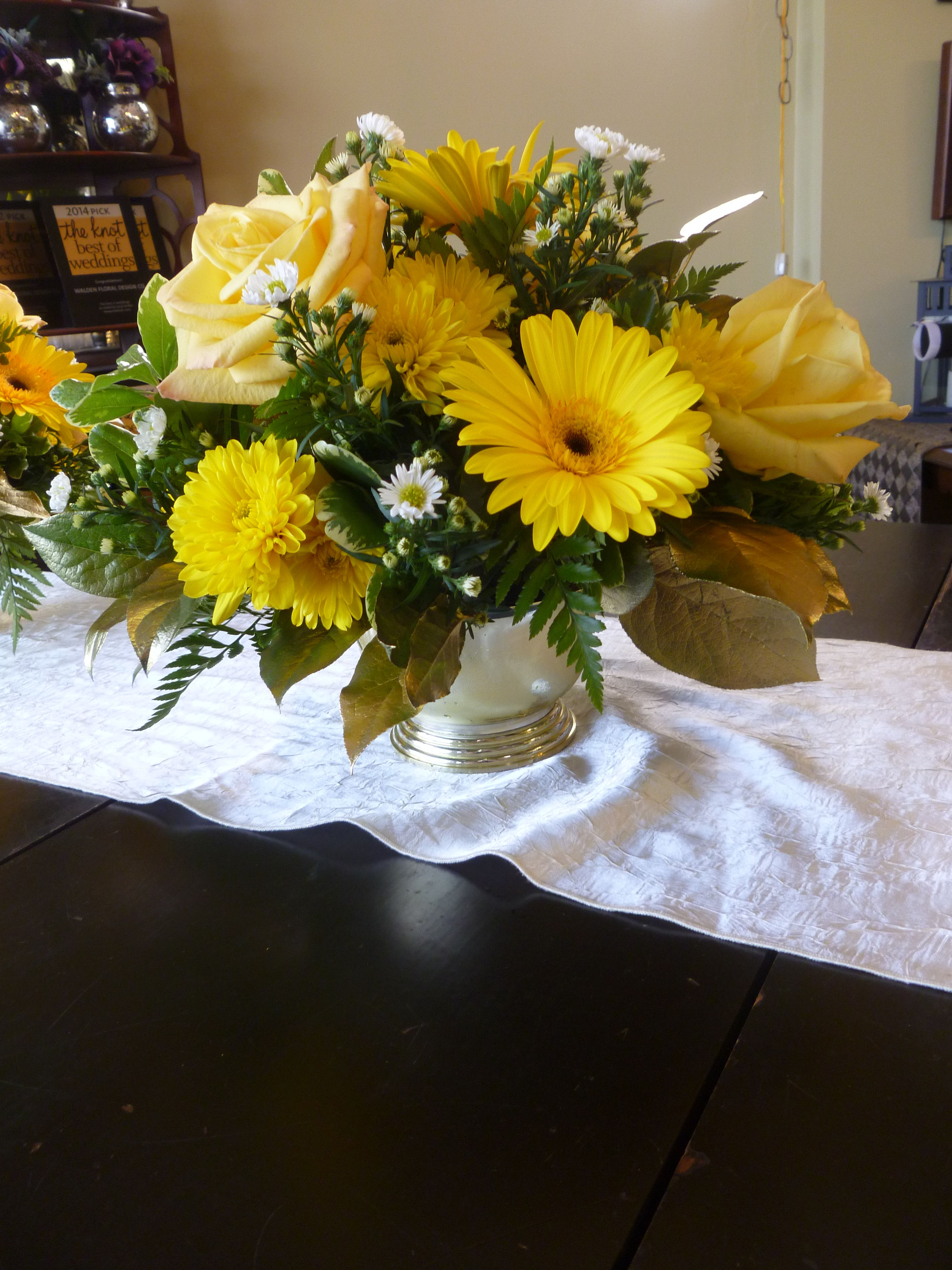 Yellow gerbera daisies skyline roses golden cushion pomps and airy yellow gerbera daisies skyline roses golden cushion pomps and airy monte casino in white create these bright centerpieces for a 50th wedding anniversary izmirmasajfo