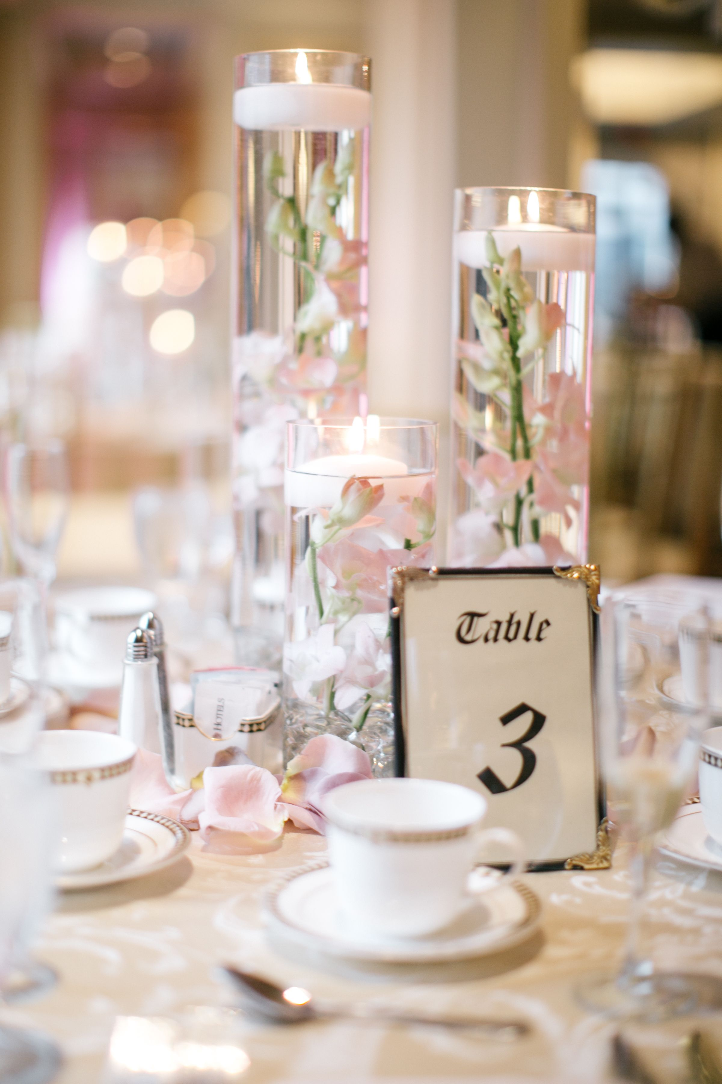 Floating Candle Centerpieces With Blush Orchids And Rose Gold Table Linens