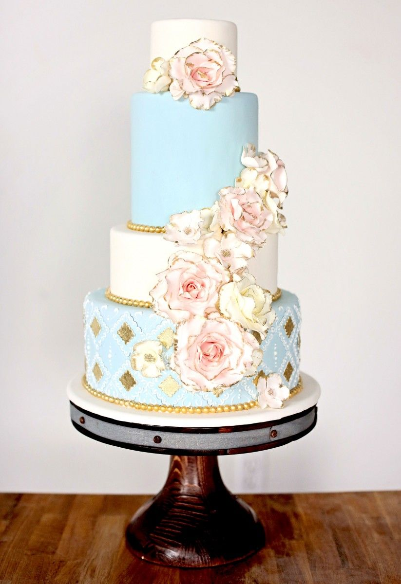 Canada s Prettiest Wedding Cakes For 2015   Pinterest   Wedding cake     Classy blue and white wedding cake with pink and cream flowers   Canada s  Prettiest Wedding Cakes For 2015 via  weddingbellsmag
