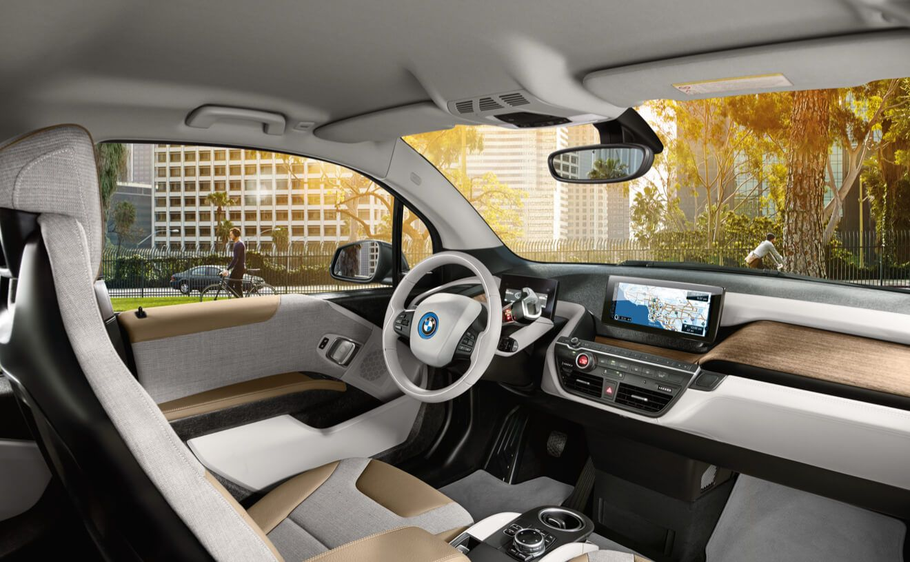 The Bmw I3 Giga World Interior Featuring Giga Cassia Natural Leather Carum Spice Grey Wool Cloth And Open Pore Eucalyptus Wood Trim Bmw I3 Bmw Bmw I