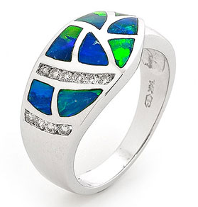 This charming 14k White Gold Solid Inlay Opal Ring has an bold design which is unparalleled in its craftmanship. To craft this daring piece, our master jeweller match together the finest Australian light crystal opal from quality opal mines in Coober Pedy, South Australia, and hand cut them into appropriate size and shape before being set into a 14K White Gold setting. Light up your look with this stunning jewellery! #opalsaustralia