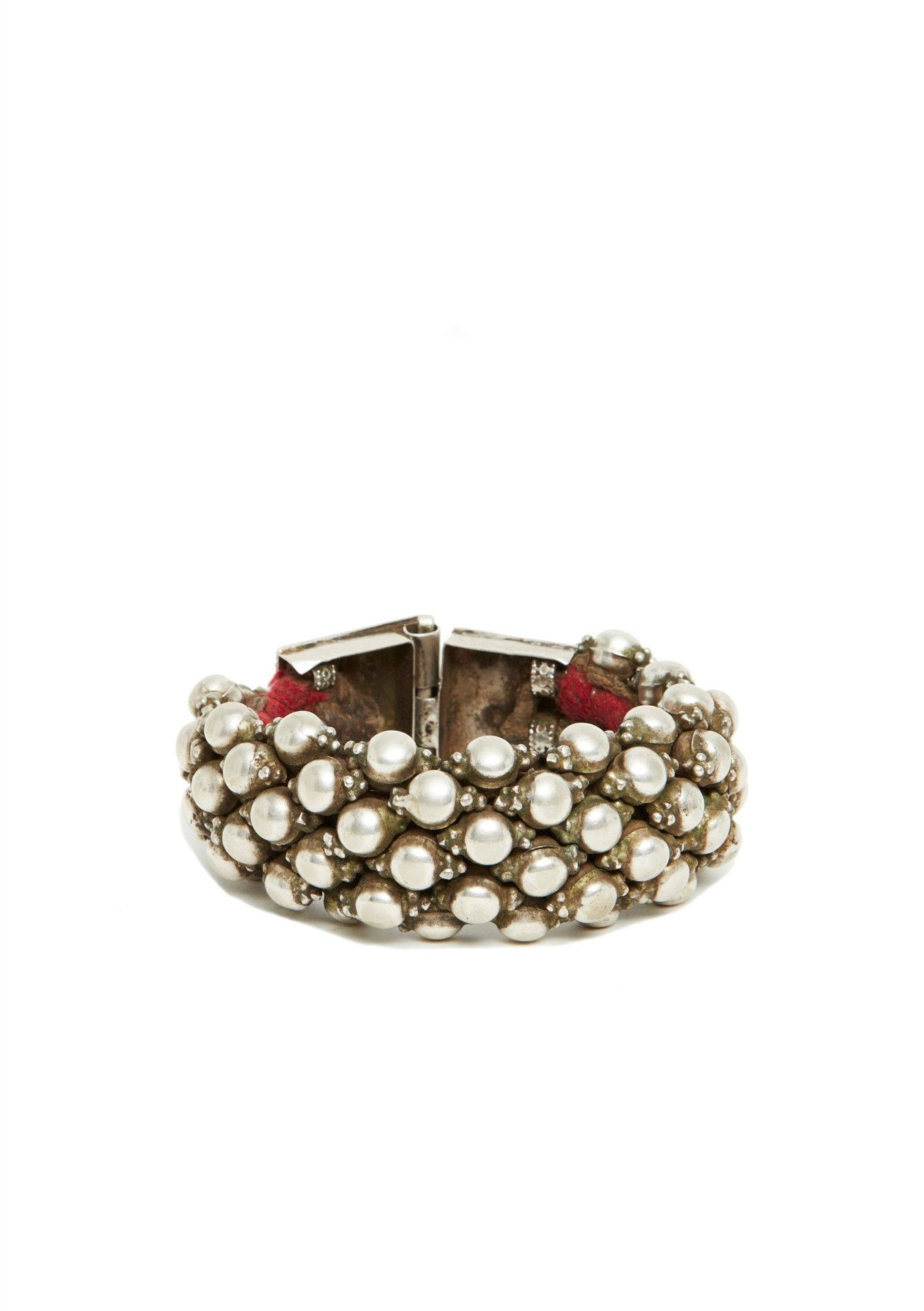 """Antique silver-plated women's bracelet with intricate dome design and square hinged clasp lined with a woven leather strap. Necessary for a well-rounded wardrobe! 1.25"""" width. As common with antique one-of-a-kind pieces, there may be irregularities or imperfections."""