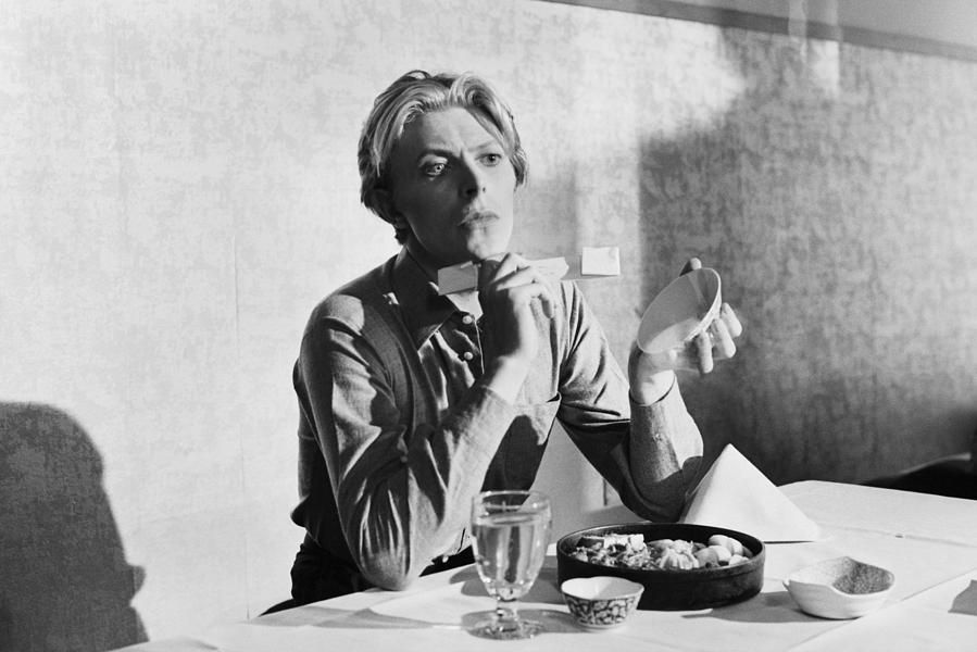 """Bowie At Lunch"": photographed by Terry O'Neill"