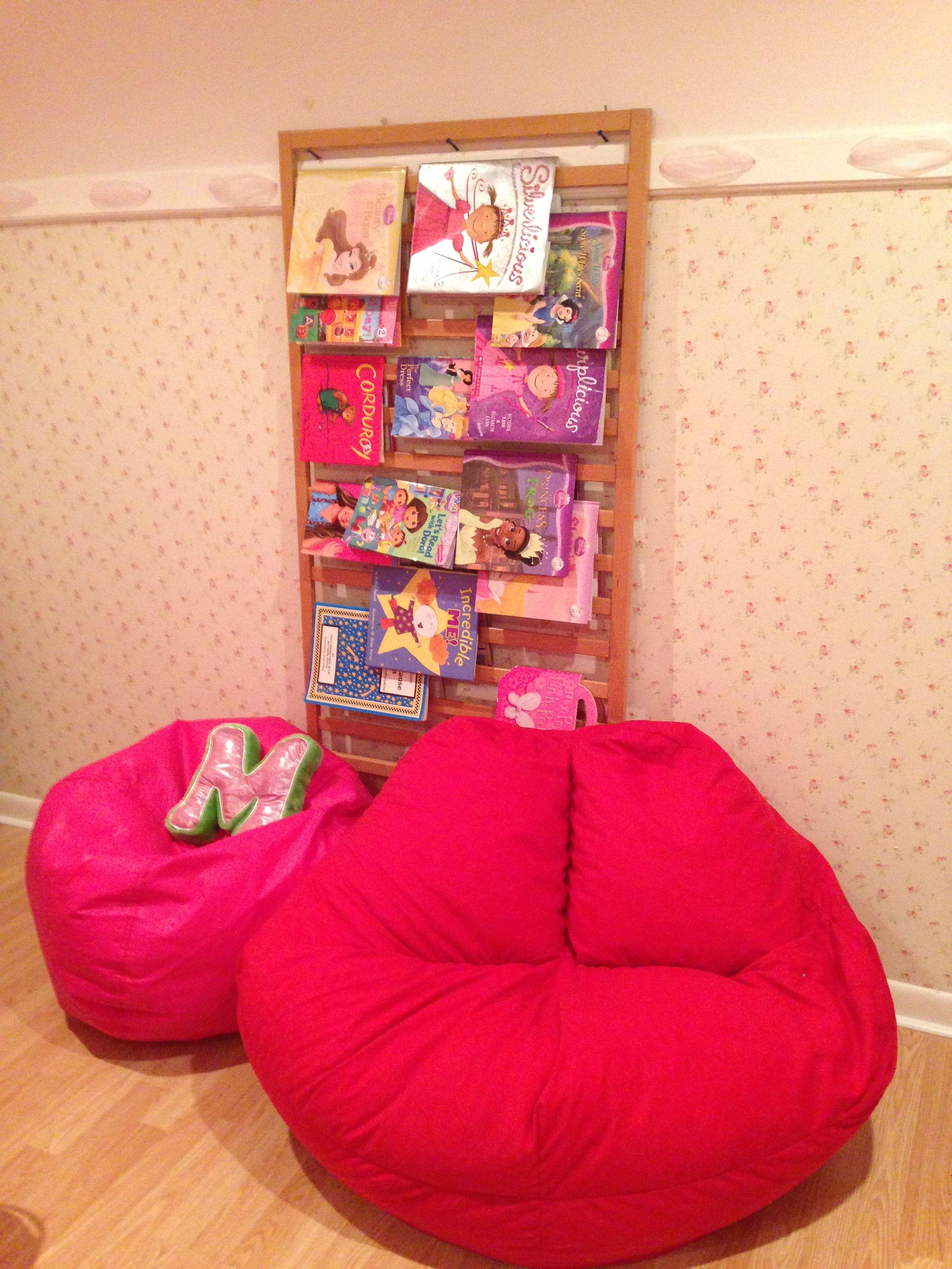 Crib rail repurposed as book holder. Tween room