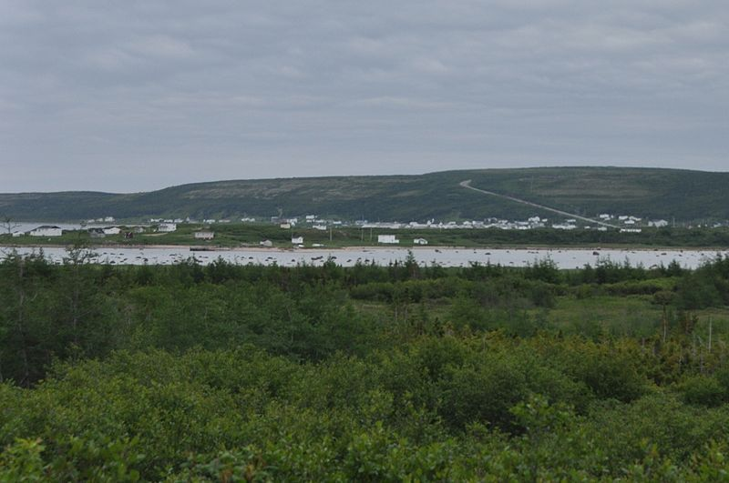 Forteau, Labrador; the Trans-Labrador Highway can be seen rising above the town.