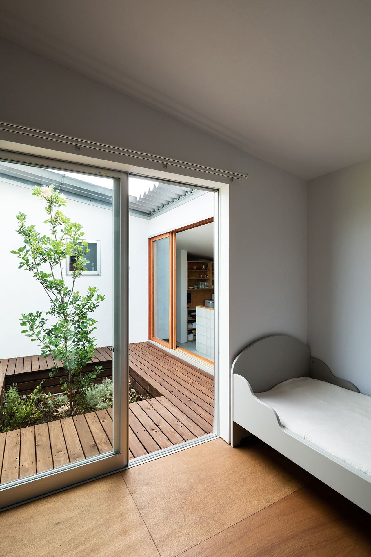 A U-Shaped House in Osaka That Opens up to a Green Landscape ... on u shaped kitchen countertops, u shaped pools, u shaped kitchen backsplash,