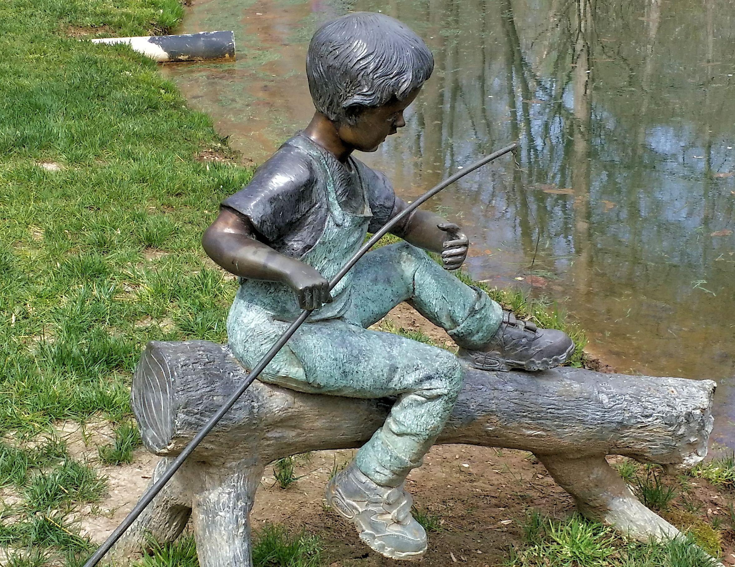 Garden statue of boy fishing at gibbs 39 garden mar 2016 for Little boy fishing statue