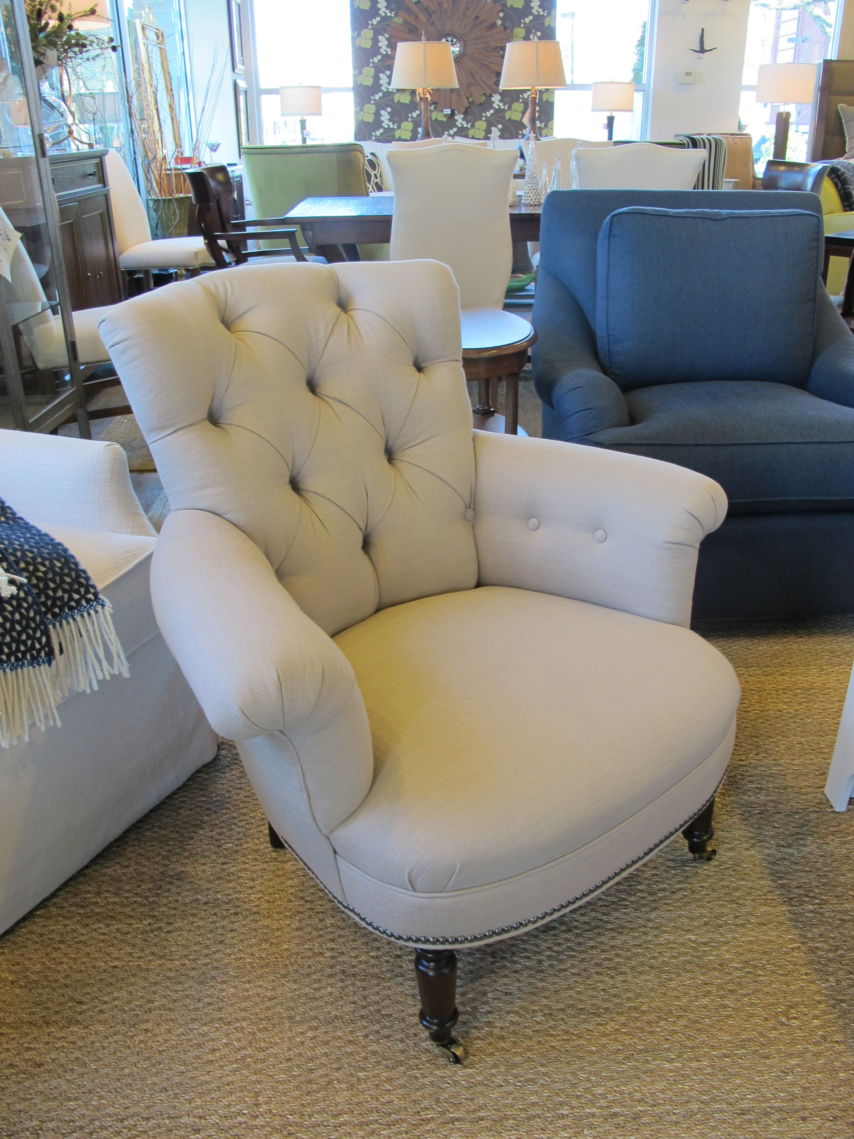 A small scale tufted chair is comfy and will fit in tight