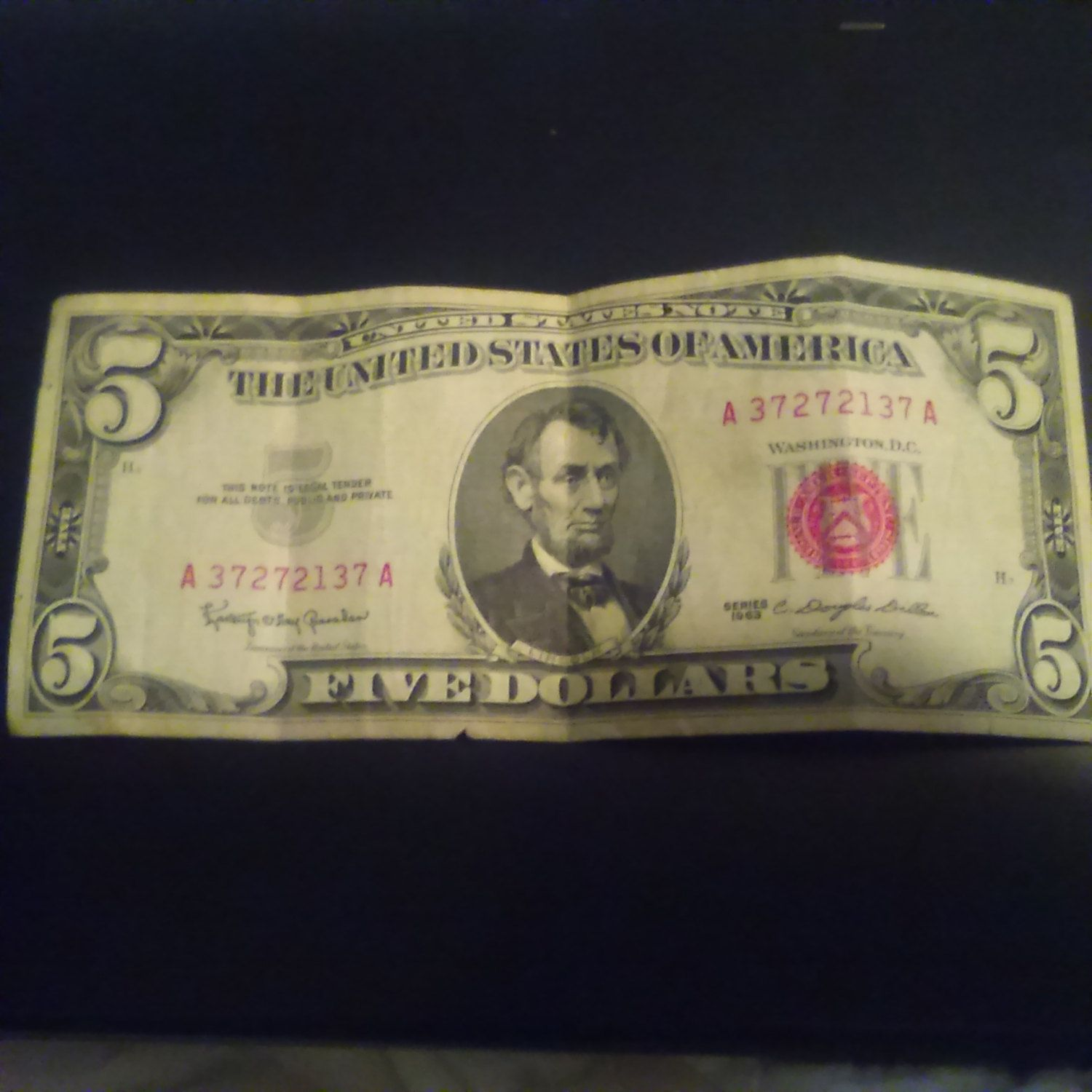 five dollar bill red serial number
