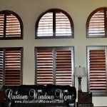 I really would love motorized shutters like this in my bed room on my high curved window! #bedrooms #decorating #windows