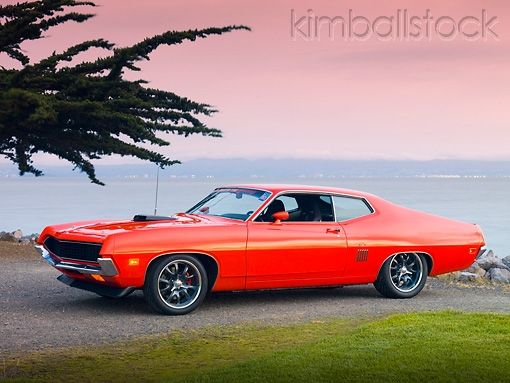 1971 Ford Torino Gt Orange 3 4 Front View On Pavement By Ocean
