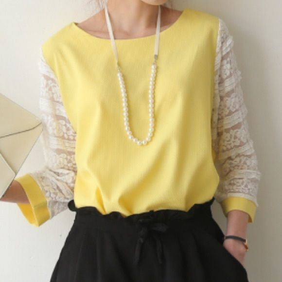Yellow loose fit blouse with lace sleeves Cheery yellow blouse with pretty lace sleeves. Loose fit. Slight high-low design. Looks best when tucked into a skirt, shorts, or pants. Tops Blouses
