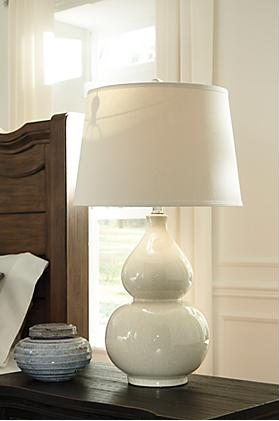 Saffi Ceramic Table Lamp By Ashley Furniture Coming Soon To Kensington S Website Ceramic Table Lamps Table Lamp Lighting Ceramic Table