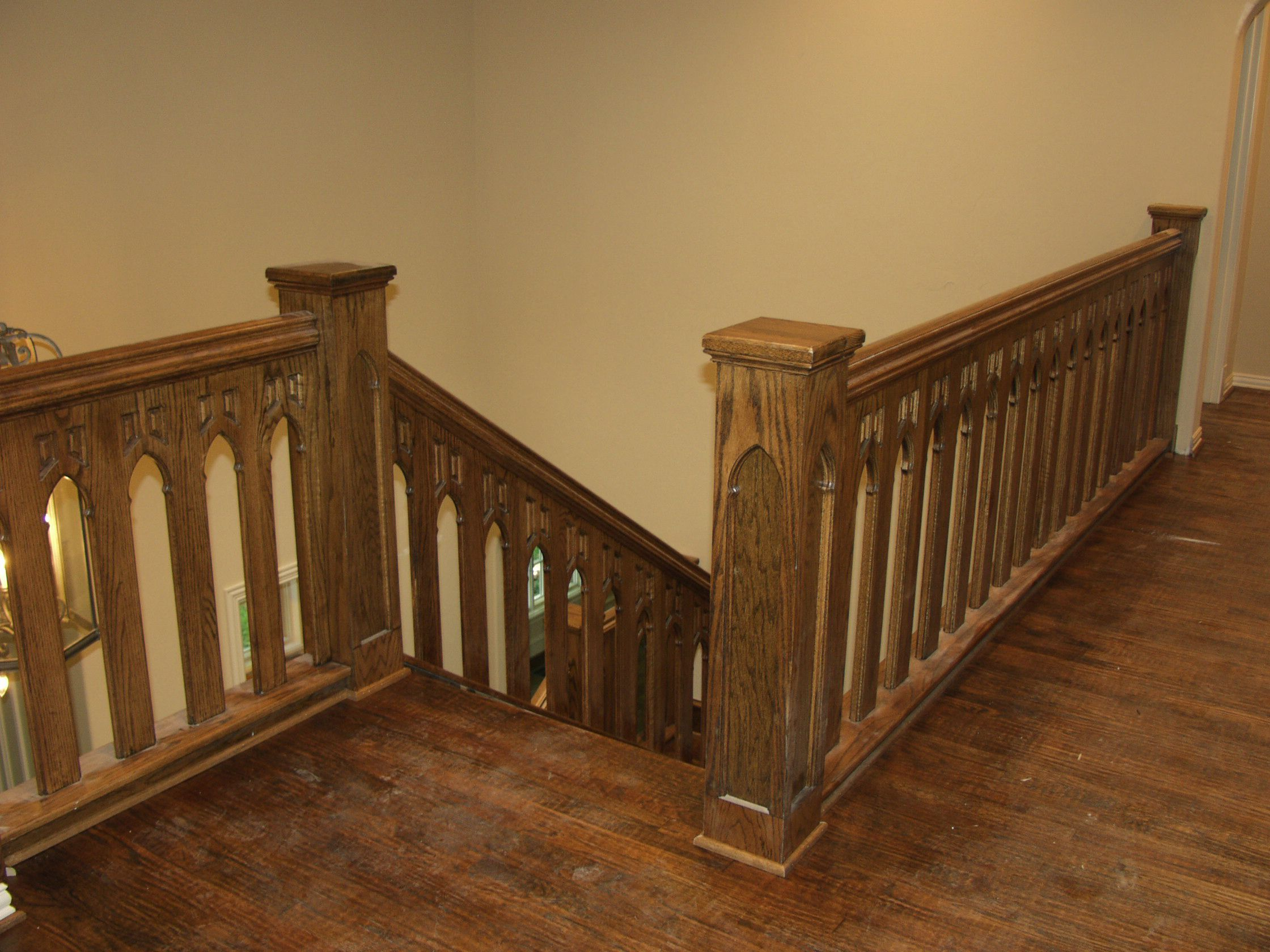 Custom Stairs Include Fabricated Iron Railings, Detailed Ornamental Wood Work,