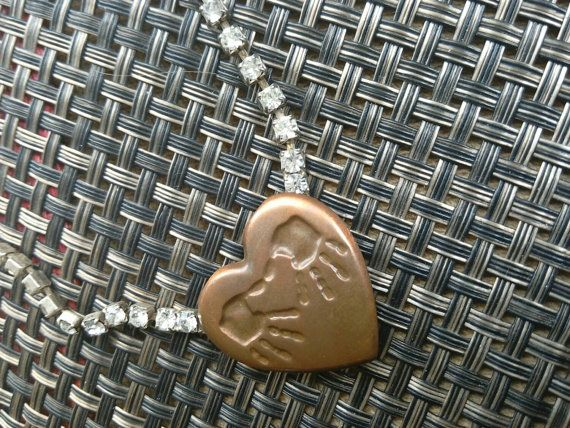 Check out this item in my Etsy shop https://www.etsy.com/listing/236670051/handprint-copper-heart-with-rhinestone